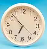 Wall clock isolated on blue Royalty Free Stock Photography