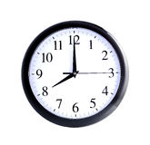Wall clock. Isolated wall clock on white background Stock Photo