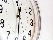 Wall clock isolated on the white background. Black numbers Royalty Free Stock Image