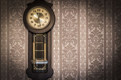 Wall clock with pendulum Stock Photography