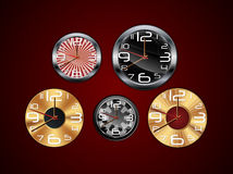 Wall clock on a red background Royalty Free Stock Image