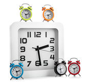 Wall clock and several alarm clock Stock Images