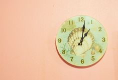 Wall Clock. Wall clock shaped shell on the ground glass Stock Images