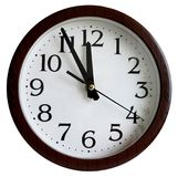 Wall clock shows midnight noon, isolated white. Wall clock, time measurement close up Stock Images