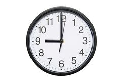 Wall clock shows time 9 o`clock on white isolated background. Round wall clock - front view. Twenty one o`clock stock photos