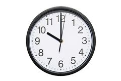 Wall clock shows time 10 o`clock on white isolated background. Round wall clock - front view. Twenty two o`clock stock image