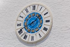Wall clock on town square. Wall clock of giant dimentions overlooking square Stock Images