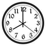 Wall clock. Vector simple classic black and white round wall clock isolated on white. Clock on wall shows eight o`clock Stock Photos