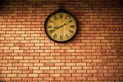 Wall Clock vintage retro styles hanging on the brick wall. Wall Clock vintage retro styles hanging on the brick wall royalty free stock image