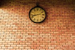 Wall Clock vintage retro styles hanging on the brick wall.  stock image