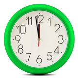 Wall clock on white background. Twelve o'clock Stock Image