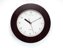 Wall clock. With white isolated background Royalty Free Stock Image