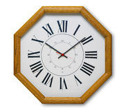 Wall clock in wood. Clock in the shape of an octagon, made out of wood, isolated with shadow and clipping path Stock Photography