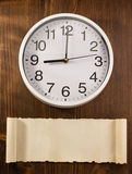 Wall clock on wood Stock Photo