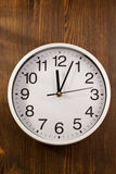 Wall clock on wood Stock Images