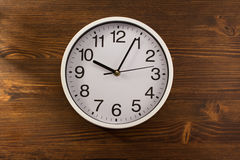 Wall clock on wood Stock Image