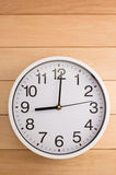 Wall clock on wood Royalty Free Stock Images