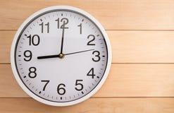 Wall clock on wood Royalty Free Stock Photos
