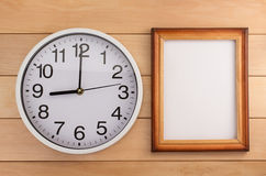 Wall clock on wood Royalty Free Stock Photo
