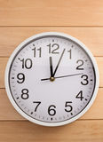 Wall clock on wood Stock Photo