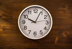 Wall clock on wood Stock Image