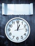 Wall clock on wood Stock Photos