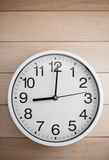 Wall clock on wood Royalty Free Stock Photography