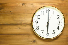 Wall clock on the wooden wall. At 6am or 6pm Stock Photos