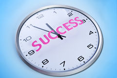 Wall clock with word success Royalty Free Stock Photo