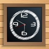 Wall clock written by color chalk on blackboard Royalty Free Stock Images