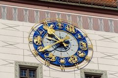 Wall clock with zodiac signs on Altes Rathaus, Munich, Germany. Wall clock with zodiac signs on Altes Rathaus at Marienplatz, Munich, Germany stock photography