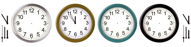Wall clocks. Aluminum wall clocks isolated on white Stock Image