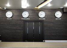 Wall clocks with different time zones. At the reception at the hotel Stock Image