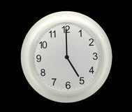 Wall clocks isolated on black. White wall clocks isolated on black Royalty Free Stock Photo