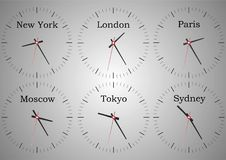 Wall clocks from the reception of the hotel showing the time of the world stock illustration