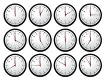 Wall Clocks - Showing All Times Stock Photography