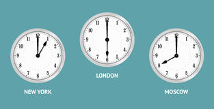 Wall clocks showing local times. Royalty Free Stock Photos