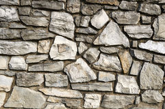The Wall. Close-up of a stone wall mosaic style Royalty Free Stock Image