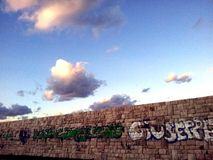 Wall and clouds Royalty Free Stock Photo