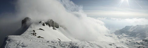 Wall of clouds and footsteps in the snow Stock Images