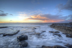 Wall. Coastal wall during sunrise on a Welsh Beach Stock Photos