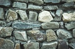 Wall from cobbles and rocks. Background image stock photos
