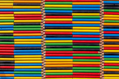 Wall of colored pencils arranged horizontally Stock Image