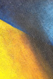 Wall with colorful blue yellow paint pattern paint Royalty Free Stock Image