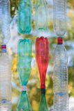 Wall of colorful empty  plastic bottles in a sunny day Stock Photography