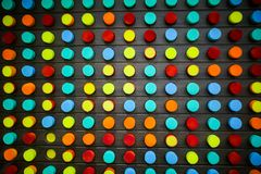 Wall with colorful rounds in the entertainment center. Mosaic from foam for kids. Happy family time playing stock photo
