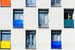 Wall with colorful windows Stock Images