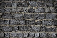 A wall composed of gray blocks. Gray wall assembled from gray stone blocks stock photography