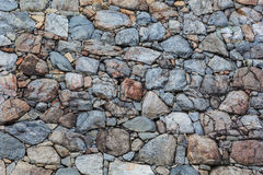 Wall composed of rocks Stock Photos
