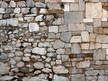Wall composed of stone slabs. Old stone wall as a background royalty free stock photography